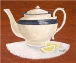 Teapot and lemon