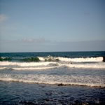 Surfers at Honoli'i Beach