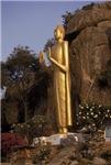 Giant Gold Buddha at Mountain