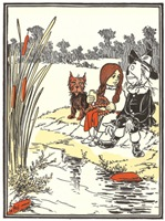A vintage illustration from the 1908 children's book, The Wizard of Oz by L. Frank Baum; Dorothy, Toto and the Scarecrow are resting by a stream while the Scarecrow tells her his story.  I was only made yesterday, said the Scarecrow.