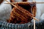 Three Knitting Needles