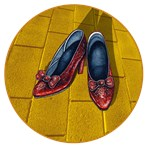 Dorothy from the Wizard of Oz is now missing her ruby red shoes.  A shadow crosses the ruby red shoes as they sit on the yellow brick road.<