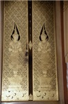 Ornate Buddist Door In Gold Relief