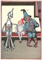 A vintage illustration from the 1907 children's book, Ozma of Oz by L. Frank Baum;  Dorothy brings the Tin Woodman and the Scarecrow up to date on her adventures.