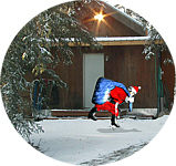 Santa with a sack of toys leaves his workshop