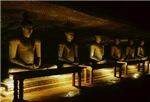 Row Of Illuminated Stone Buddas