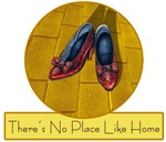There's No Place Like Home proclaims the sign sitting below the Ruby Red Shoes sitting on the Yellow Brick Road from the Wizard of Oz.