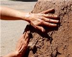 Hands Mudding Adobe