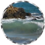 Waves crashing over rocks 72243