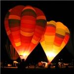 Two Glowing Rainbow Balloons
