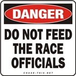 DANGER:  DO NOT FEED<br/>THE RACE OFFICIALS