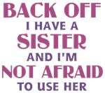 Back Off I have a sister and I'm not afraid to use her. In Pink Text. Funny saying / quote in pink and purple text.