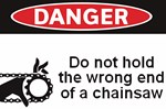 Danger. Do not hold the wrong end of a chainsaw