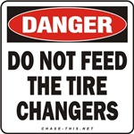 DANGER:  DO NOT FEED<br/>THE TIRE CHANGERS