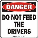 DANGER:  DO NOT FEED<br/>THE DRIVERS